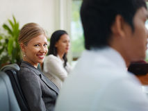 Businesspeople in meeting room and woman smiling Stock Images
