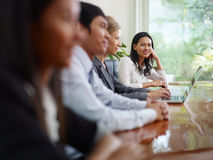 Businesspeople in meeting room and woman smiling Royalty Free Stock Image