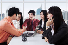 Businesspeople in a meeting shaking hands Royalty Free Stock Photo