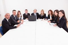 Businesspeople in meeting. Businesspeople Sitting At Conference Table At The Meeting stock image