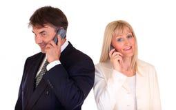 Businesspeople met mobiles stock afbeelding