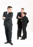 Businesspeople - mobbing. Business people (multi-ethnic) pointing their fingers on a colleague - mobbing Stock Photography