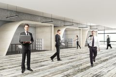 Conference concept. Businesspeople in modern coworking office interior. Conference concept. 3D Rendering Stock Photos