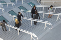 Businesspeople Moving Up And Down Stairs. High angle view of businesspeople moving up and down stairs royalty free stock images