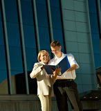 Businesspeople near a office building Stock Images