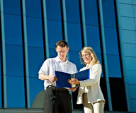 Businesspeople near a office building Stock Image