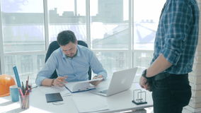 Businesspeople in office. Businesman bringing documents, boss signing. stock video