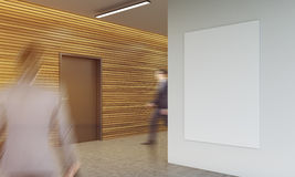 Businesspeople in office corridor. Two man in suits walking in corridor of modern building against wooden wall background. Hanging vertical poster. Concept of Stock Image