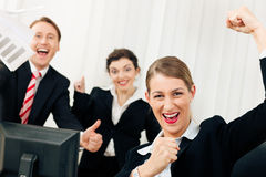 Businesspeople in office having great success Stock Image
