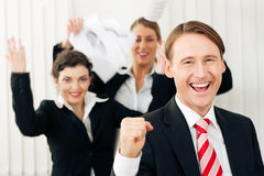 Businesspeople in office having great success. Business people having a lot of fun and letting it show, maybe they are lawyers looking at a favorable ruling stock photos
