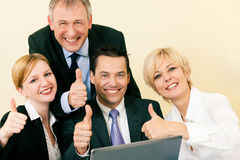 Businesspeople in office having great success Royalty Free Stock Photo