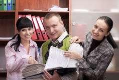 Businesspeople in office space with notes smiling Stock Image