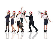 Businesspeople people in a Santa Claus hat. With loudspeaker on the white background Stock Images
