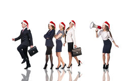 Businesspeople people in a Santa Claus hat. With loudspeaker on the white background Stock Image