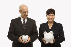 Businesspeople with piggybanks stock photography