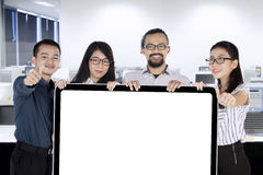 Businesspeople with placard and OK sign Stock Images