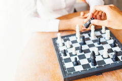 Businesspeople playing chess in office stock photography
