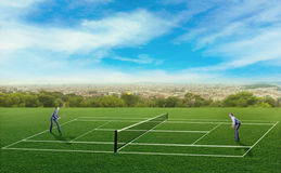 Businesspeople playing tennis Stock Image