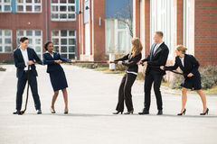 Businesspeople Playing Tug Of War Royalty Free Stock Images