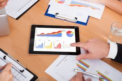 Businesspeople pointing on digital tablet Royalty Free Stock Photography