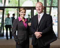 Businesspeople posing in lobby Royalty Free Stock Photo