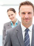 Businesspeople posing together front of a camera Royalty Free Stock Photography