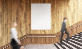 Businesspeople and poster. Side view of blank poster on wooden wall and businesspeople climbing stairs. Mock up, 3D Rendering Royalty Free Stock Photography