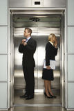 Businesspeople Preparing For Interview In Elevator Stock Image