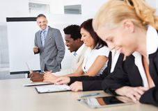 Businesspeople at presentation Stock Photography