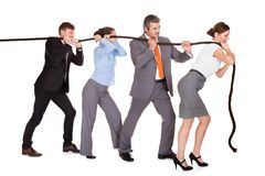 Businesspeople Pulling Rope. Group Of Businesspeople Pulling Rope Over White Background royalty free stock photography