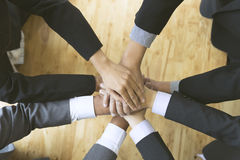 Businesspeople put their hand on top of each other - teamwork, u Stock Images
