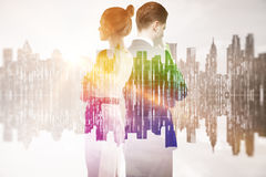 Businesspeople in rainbow city. Thoughtful businesspeople on abstract rainbow cityscape background. Double exposure Royalty Free Stock Photography