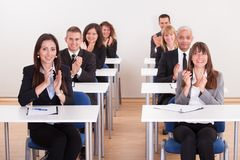 Businesspeople Raising Their Hands royalty free stock images