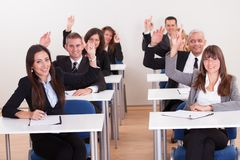 Businesspeople Raising Their Hands Royalty Free Stock Image