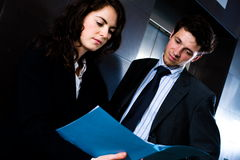 Businesspeople reading document Royalty Free Stock Photography