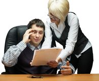 Businesspeople reading documents. Boss with assistant reading documents in office Royalty Free Stock Photo