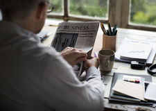 Businesspeople Reading Newspaper at Office Updating News. Businessman Reading Newspaper at Office Updating News Royalty Free Stock Image