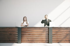 Businesspeople at reception desk Royalty Free Stock Images