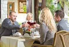 Businesspeople in restaurant having a toast Royalty Free Stock Image