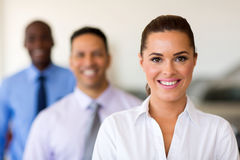 Businesspeople in a row. Three smiling businesspeople standing in a row Stock Image