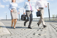 Businesspeople running on bridge Royalty Free Stock Images