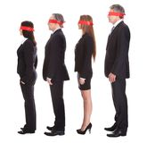 Businesspeople's Eyes Covered With Ribbon Stock Photo