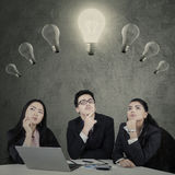 Businesspeople searching inspiration Stock Images