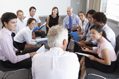 Businesspeople Seated In Circle At Company Seminar Royalty Free Stock Photography