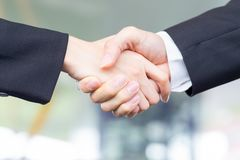 Businesspeople shake hand. Closeup of Businesspeople shake hand after a meeting stock photos
