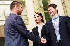 Businesspeople shake hands Stock Photo