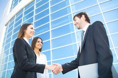 Businesspeople shake hands Stock Photos