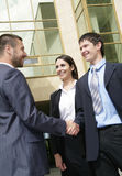 Businesspeople shake hands Stock Images