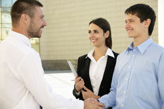 Businesspeople shake hands Stock Photo