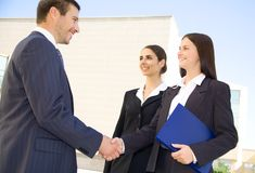 Businesspeople shake hands Stock Photography